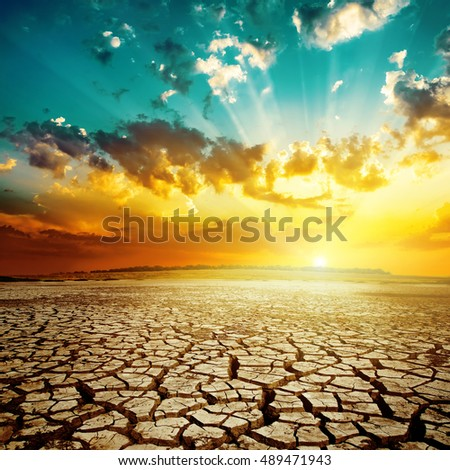 sunset over drought earth. natural disaster