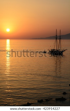 Sunset over the Aegean sea with boat