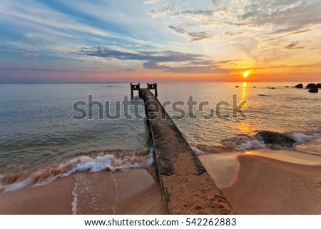 Sunset over the sea at Phu Quoc island in Vietnam. Pier on the foreground