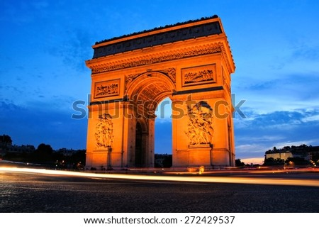 Sunset view of the Arc de Triomphe monument with beautiful blue sky, Paris, France