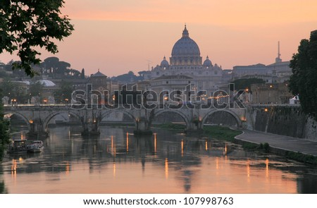 Sunset view of the Vatican with Saint Peter's Basilica and Sant'Angelo's Bridge Rome Italy