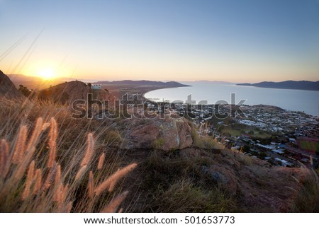 Sunset view of Townsville, Queensland, Australia looking from Castle Hill towards the coast and calm sea
