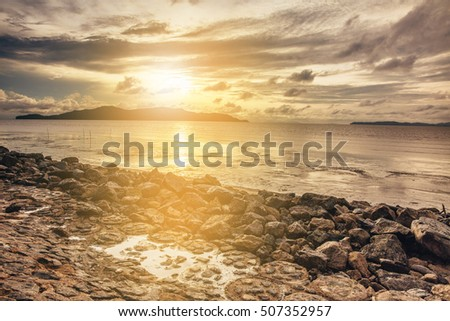 Sunset view over Baltic sea with stones.
