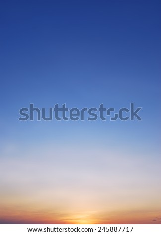 Sunset with soft blue sky background