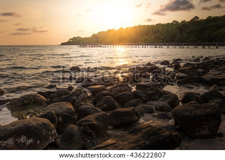 Sunset with the rock beach