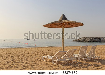 sunshade shelter and seats on beach in Fujairah