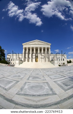 Supreme Court of the United States in Washington D,C. Blue sky behind and white clouds. Fisheye photo.