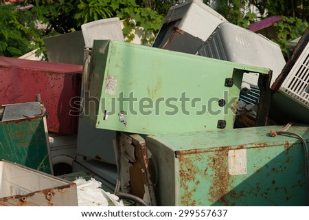 Suratthani,Thailand, July 24,2015:Old refrigerator that is broken or breaking the pile at the plant waste for recycling.
