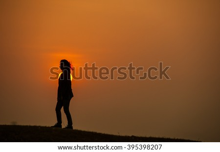 Suratthani,Thailand, March 19,2016: Asian teen girl silhouette happy cheerful nature morning sun Scenic Park.
