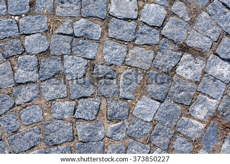 surface - gray cobblestones as the background texture