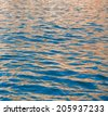 surface seawater covered with colorful reflections - stock