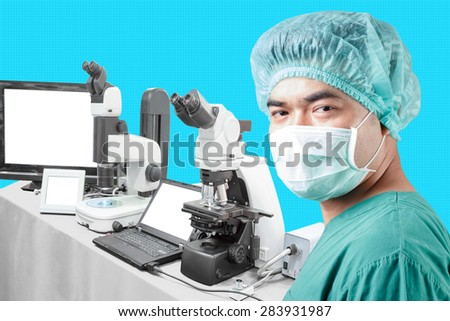 Surgeon looking at camera and equipment tools in lab for diagnosis disease