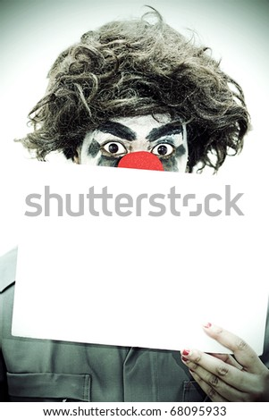 Surprise Birthday Clown Peers Over A Blank Sign With A Look Of Wide Eye Shock In A Party Invitation Concept