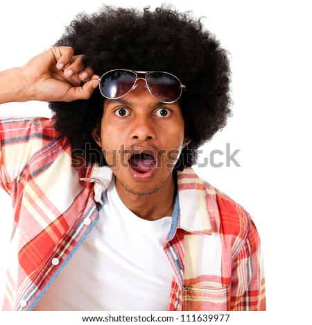 Surprised black man taking a good look - isolated over a white background