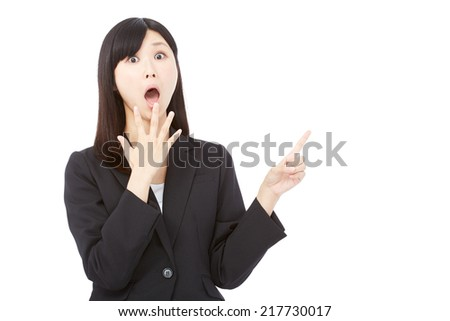 surprised businesswoman pointing side