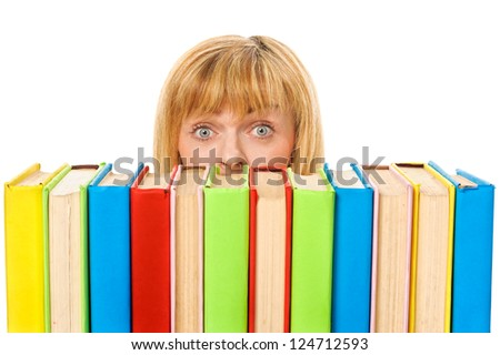 Surprised girl with stack color books. Isolated over white