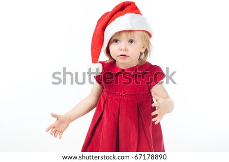 Surprised little girl in red dress and santa cap isolated on white
