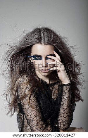 Surrealism. Young woman with a mask on the eyes.