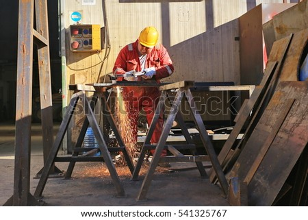 Susa, Italy - december 22, 2016: welder working outside in the metal construction site
