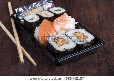 sushi box with assorted sushi pieces