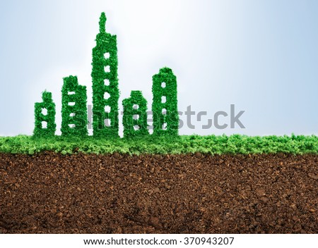 Sustainable urban development concept with grass growing in shape of a city