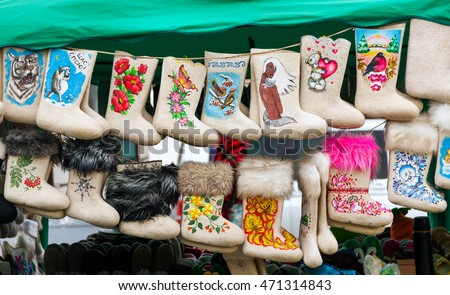 Suzdal, Russia - May 3, 2014: Traditional russian felt boots on trade counter in Suzdal, Russia