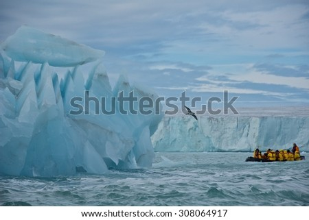 Svalbard, Norway -  Circa July 2013: Cruising along giant iceberg and glacier in Nordaustlandet, Svalbard