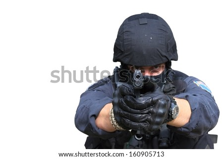 swat police officer pointing a gun at the camera, close-up, isolated on white