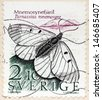 SWEDEN - CIRCA 1987: A stamp printed by SWEDEN shows Clouded Apollo (Parnassius mnemosyne) - butterfly species of the family of Swallowtail butterflies found in Eurasia, circa 1987. - stock photo