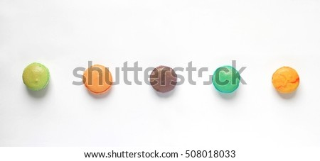Sweet and colourful french macaroons or macaron in row on white background, Dessert.