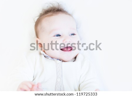 Sweet baby girl laughing and playing