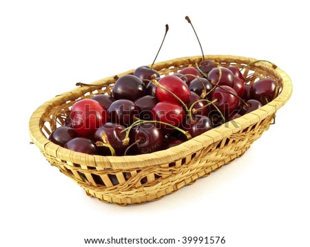 sweet cherries in basket on white background