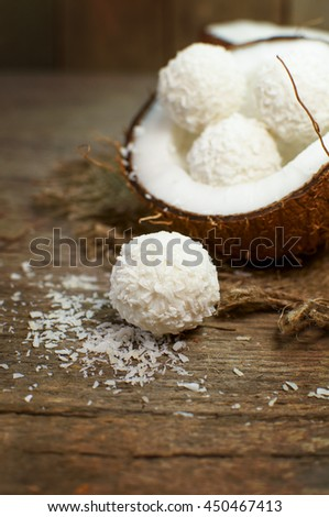 Sweet coconut candy on a wooden surface