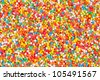 sweet colorful candies spreading pastry decoration background - stock photo