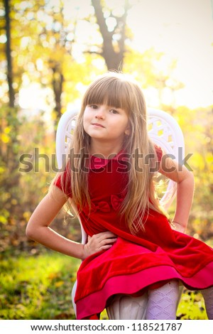 Charming Little Girl Red Dress Sitting Stock Photo