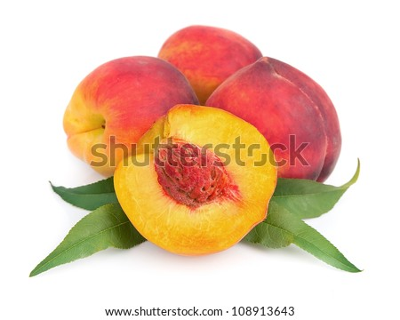 Sweet peaches with leafs on a white background