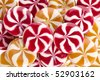 Sweet round colorful striped candies - stock photo