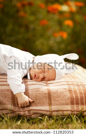 sweet sleeping baby with rabbit costume