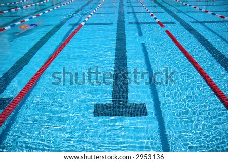Swimming pool and swimmer practicing