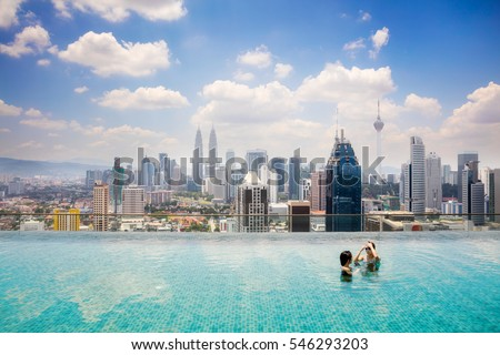 Swimming pool on roof top with beautiful city view Kuala lumpur, Malaysia.
