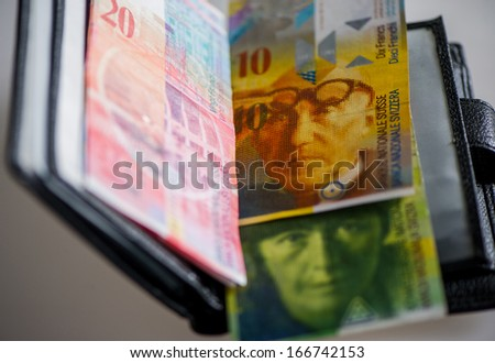 Swiss Franc advantages fifty, ten, twenty in your wallet on a light background