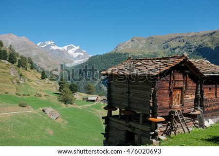 Swiss mountain panorama with old wooden chalets