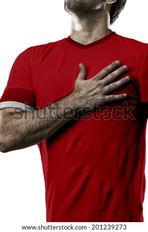 Swiss soccer player, listening to the national anthem with his hand on his chest. On a white background.