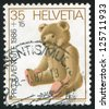 SWITZERLAND - CIRCA 1986: A stamp printed by Switzerland, shows Teddy bear, circa 1986 - stock photo