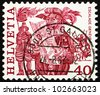 SWITZERLAND - CIRCA 1979: a stamp printed in the Switzerland shows Herald Reading Proclamation and Men Scaling Wall, Escalade, Geneva, Folk Customs, circa 1979 - stock photo