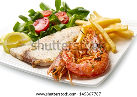 swordfish and grilled prawns with potatoes