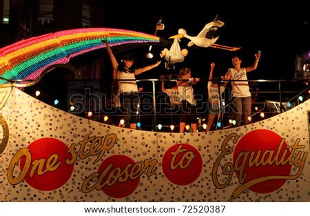 SYDNEY, AUSTRALIA - MARCH 5: Some women dance on the big car at parade on March 5, 2011 for Mardi Gras in Oxford Street, Sydney, Australia. Mardi gras is an annual event for gay/lesbian acceptance.
