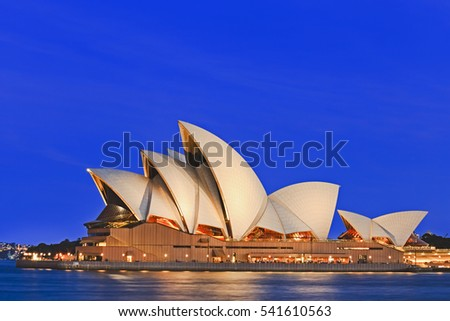 Sydney, Australia - 15 November 2016: Iconic worlds' buildings - Sydney Opera house in full glory at sunset, brightly illuminated.
