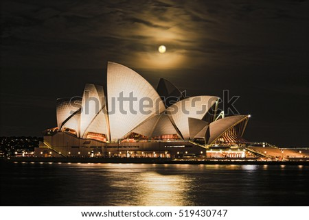 Sydney, Australia - 15 November 2016: Super full rusty moon rising over Sydney Opera House in Australia during unique astronomy event on dark night