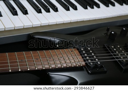 Synthesizer and electric guitar, closeup